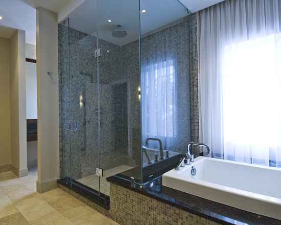 lavish-luxury-shower-and-tub-skirt-shower-connected-to-bathtub-as-bench-with-full-mosaic-tile-on-side-of-tub-matching-shower